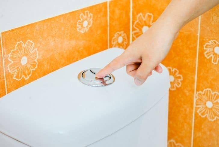 man-finger-on-flush-button