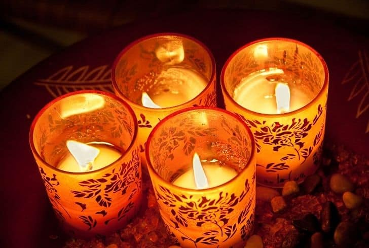 lit-candles-decorated-glass