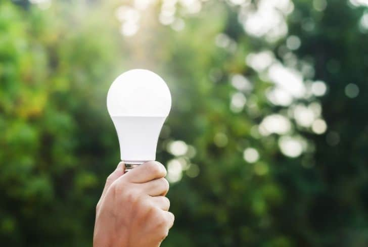 man-holding-led-bulb-in-hand