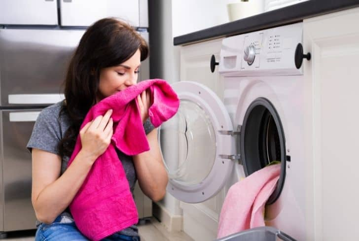 women-smelling-clothes